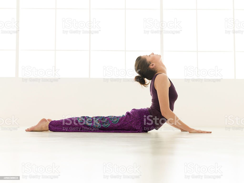 advanced yoga pose indor stock photo