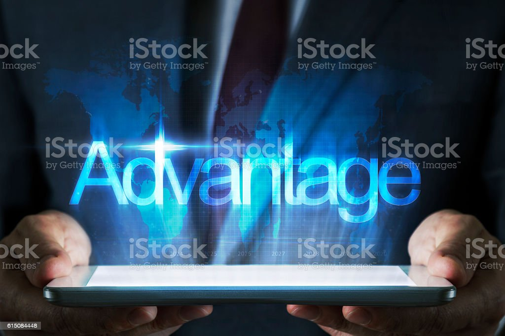 Advantage concept on tablet with hologram stock photo