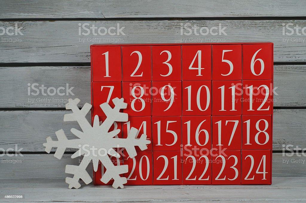 Advent calendar and snowflake stock photo