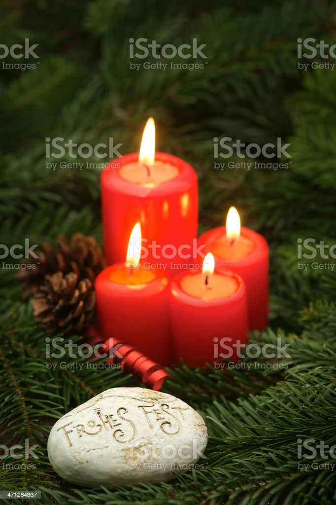 Advent Candles with German Christmas Greeting stock photo