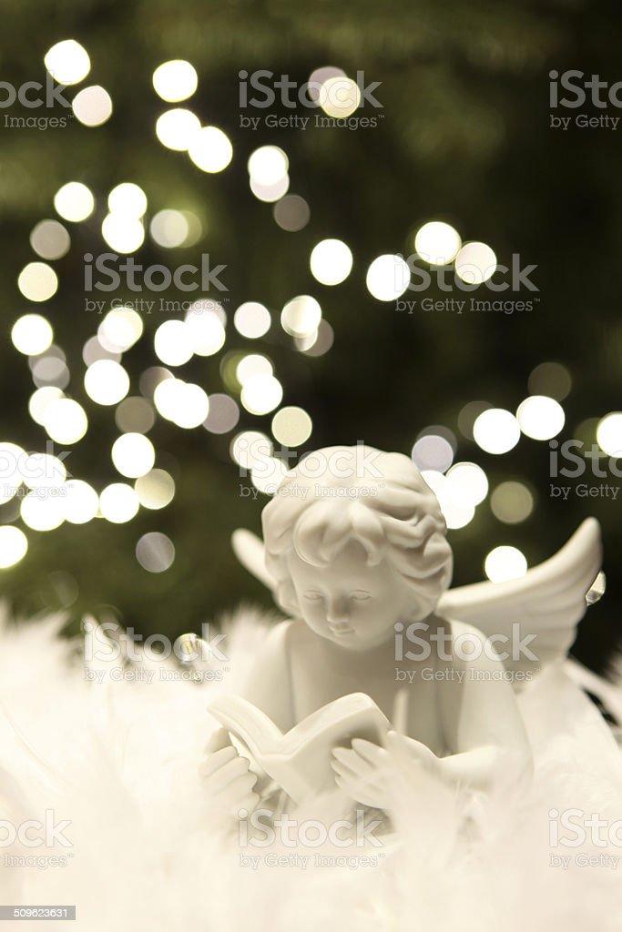 Advent Christmas Angel Figurine and Blur Christmas Lights stock photo