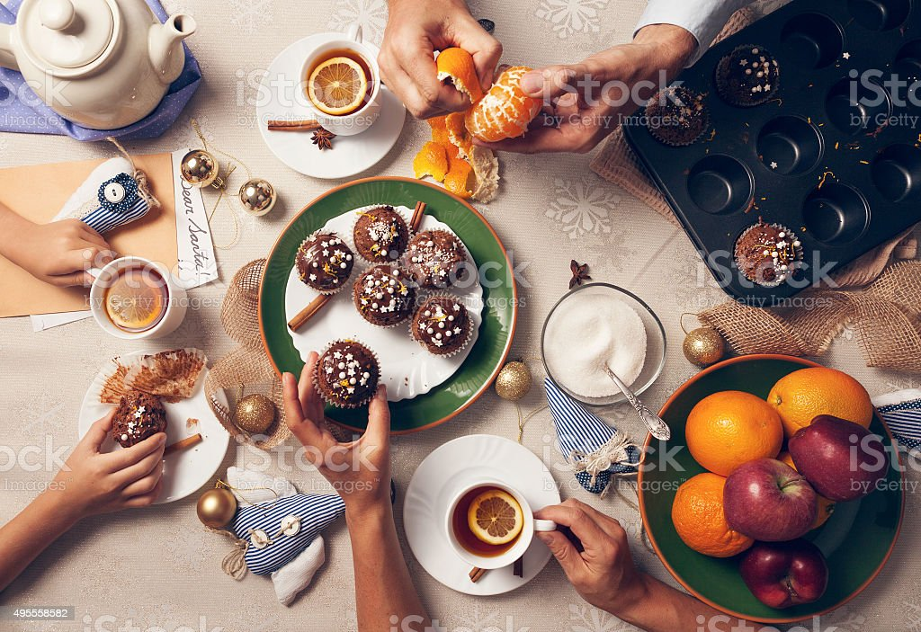 Advent time. Family tea party with homemade muffins stock photo