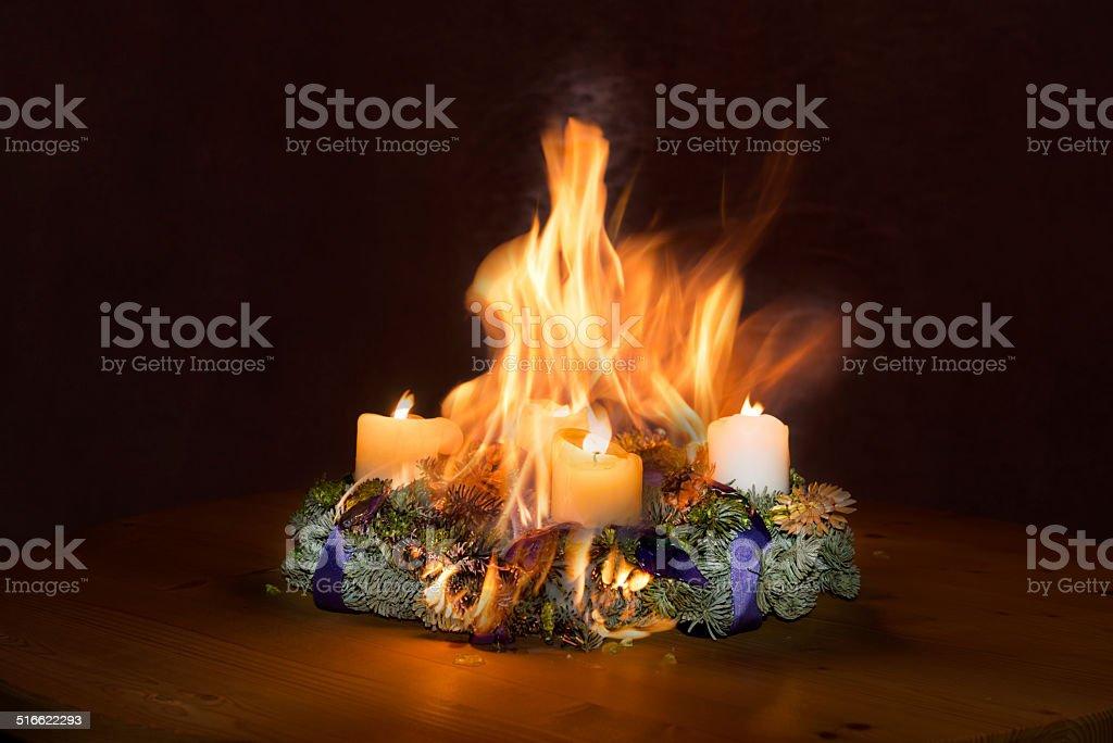Advent wreath caught fire stock photo
