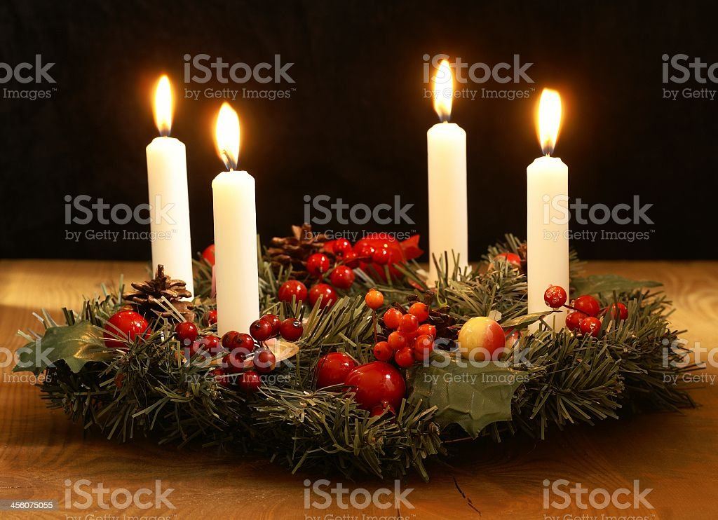 Advent wreath with four candles and berries royalty-free stock photo