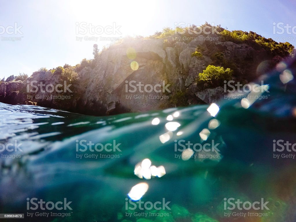 Adventure Holiday Rock Carvings on Lake stock photo