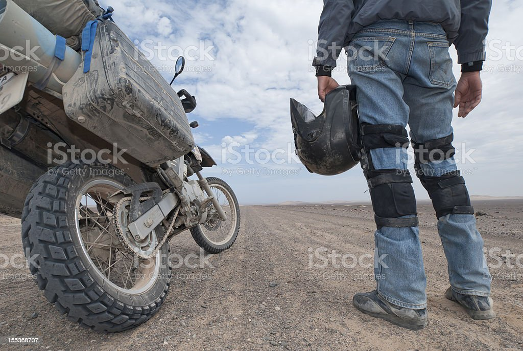 adventure motorcycle rider stands next to bike royalty-free stock photo