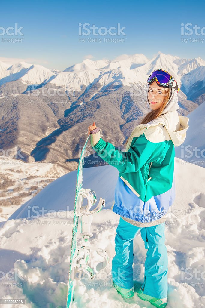 Adventure to winter sport. Snowboarder girl stock photo