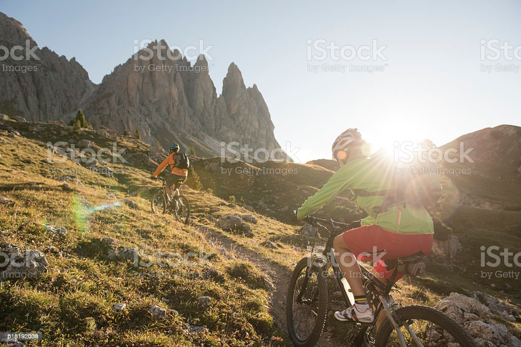 Adventure with the mountain bike in the Dolomites stock photo