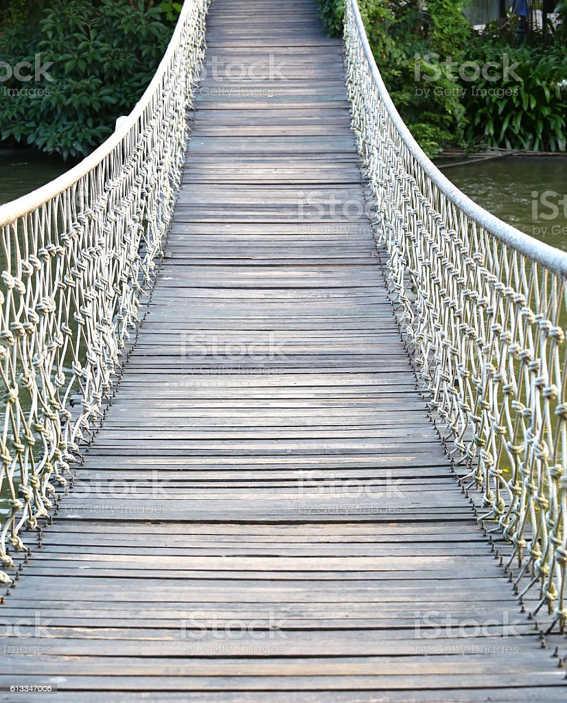 Adventure wooden rope suspension bridge stock photo