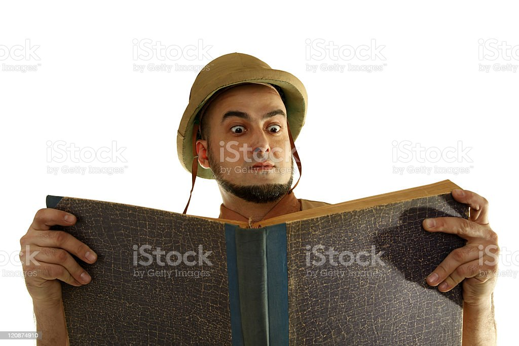 Adventurer explorer is reading old mysterious book royalty-free stock photo