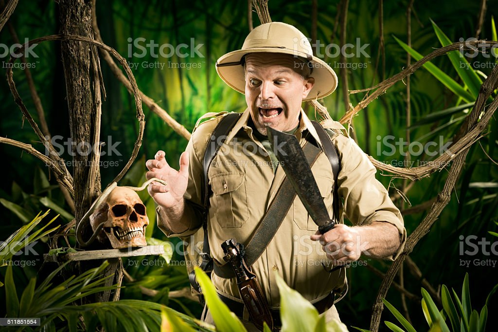 Adventurer finding a skull stock photo