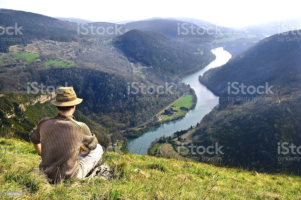 Adventurer gazing at the view stock photo