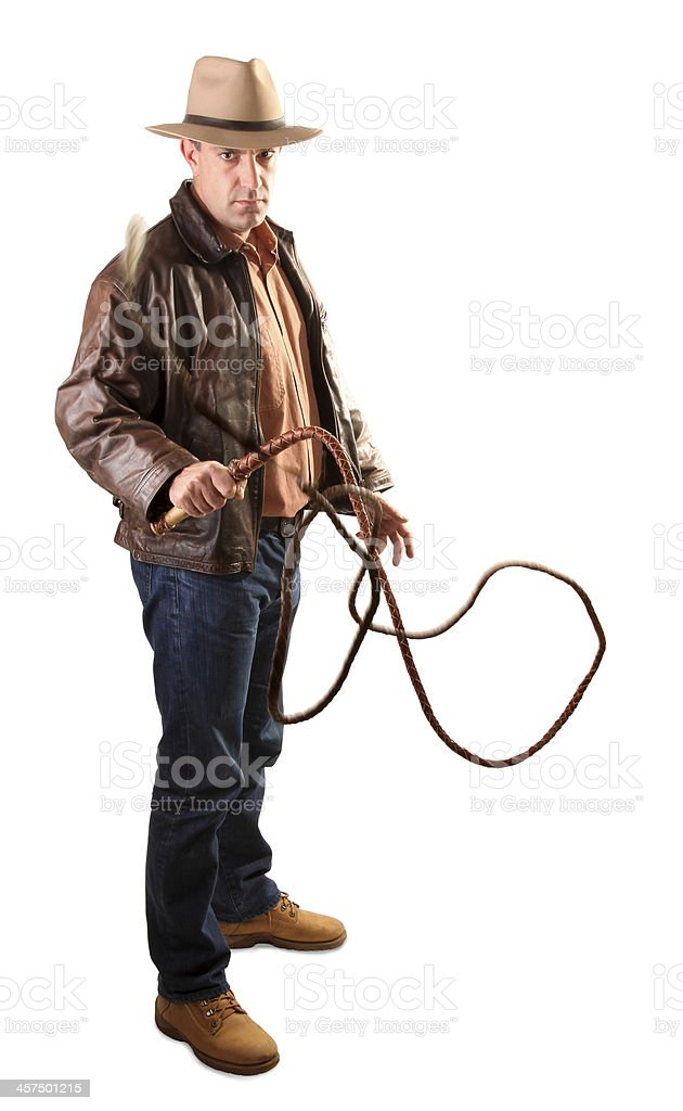 Adventurer treasure hunter is swinging with bull whip stock photo