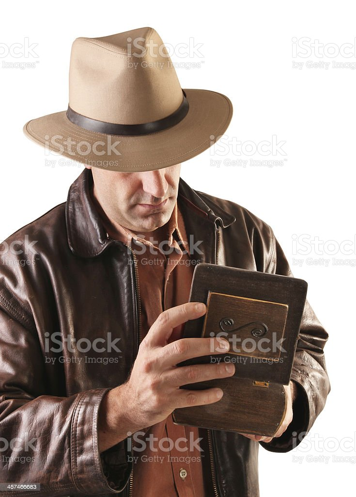 Adventurer treasure hunter opens wooden box stock photo