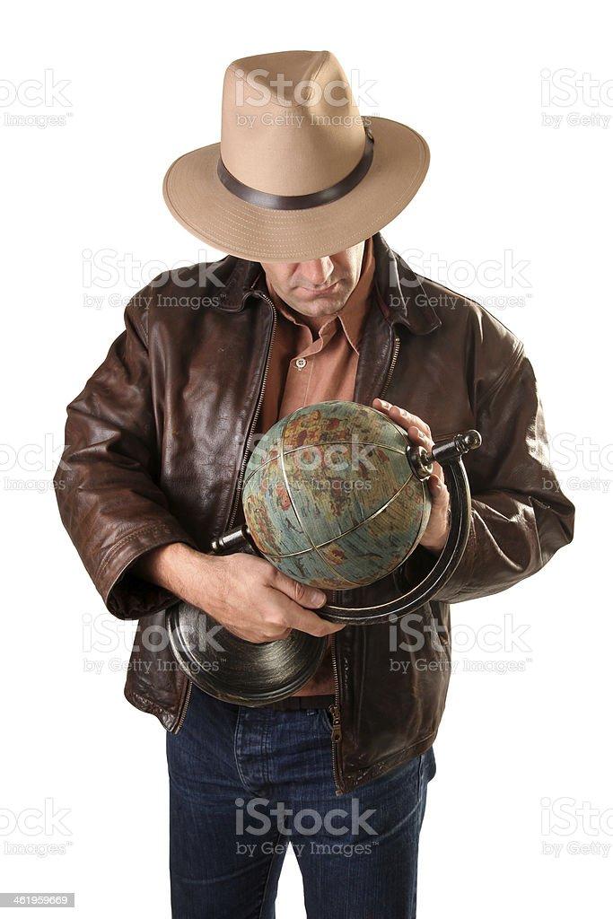 Adventurer treasure hunter with vintage globe stock photo