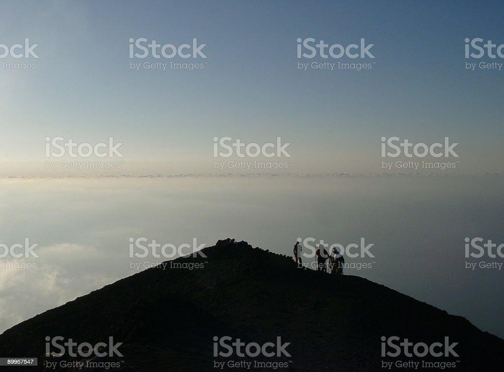 adventurers on top of the volcano mountain peak, Stromboli, Sici royalty-free stock photo