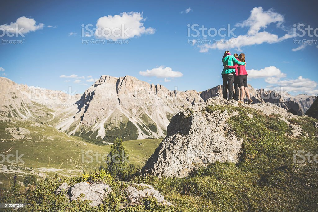 Adventures on the mountain: women  hug together stock photo