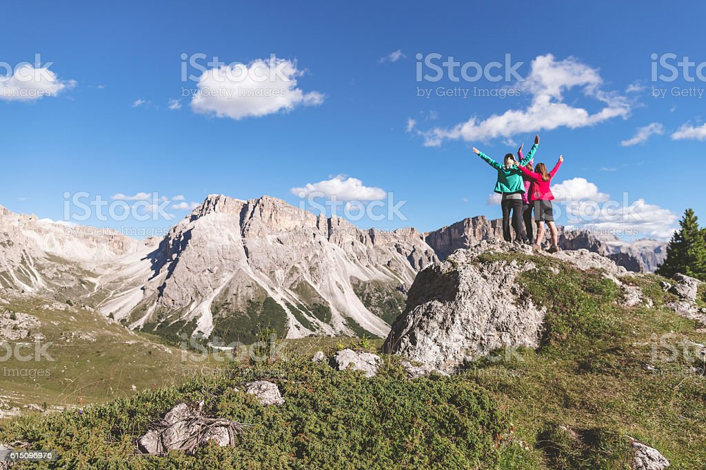 Adventures on the mountain: women together on the top stock photo