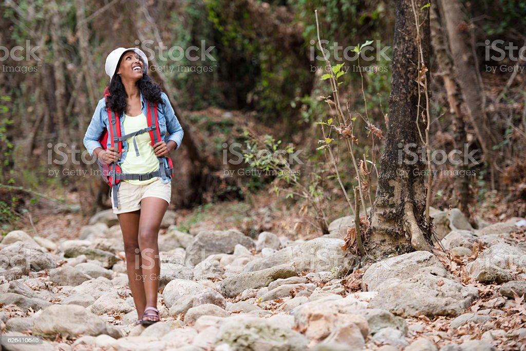 Adventurous woman enjoying nature in forest. stock photo