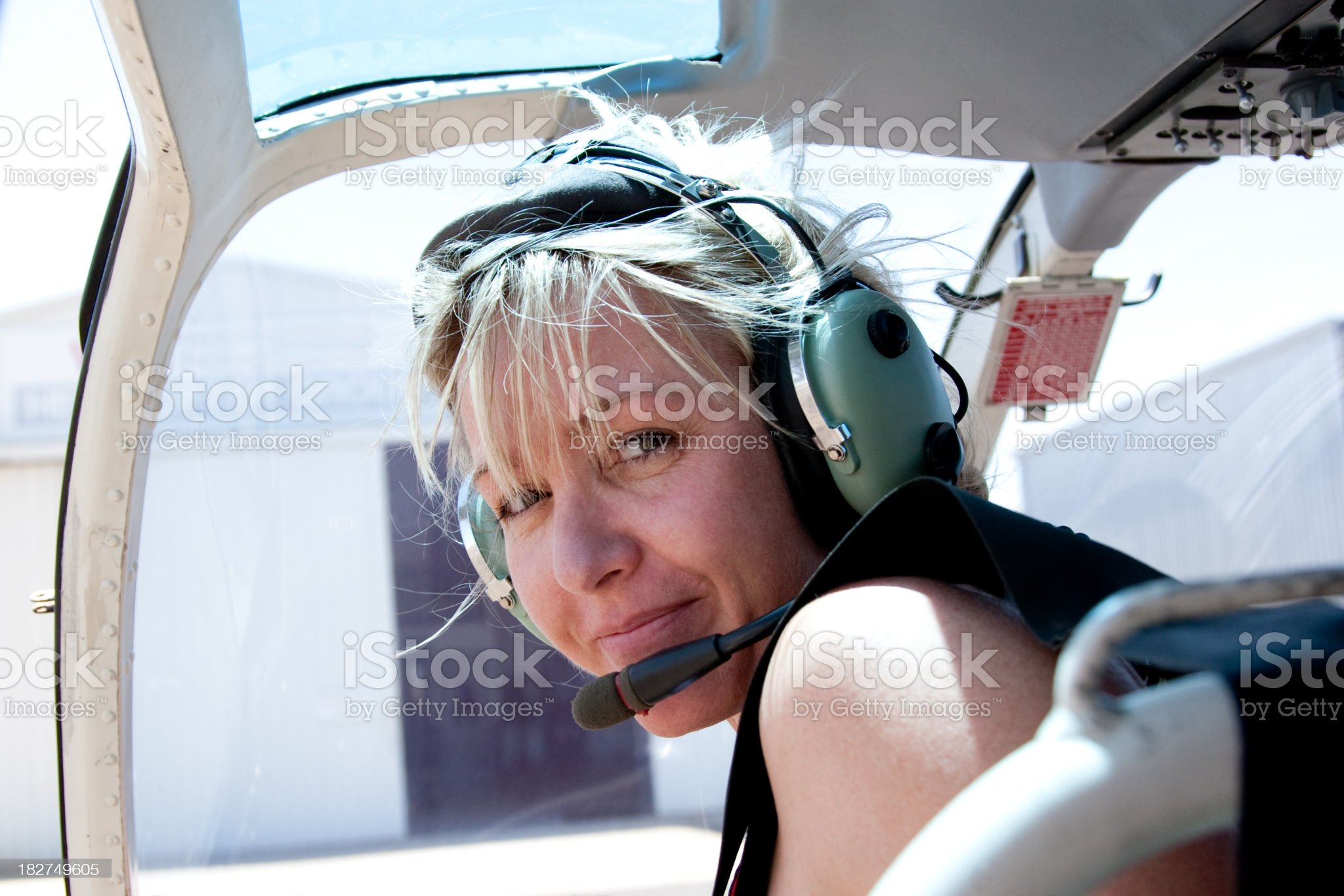 Adventurous Woman in Helicopter with headset royalty-free stock photo