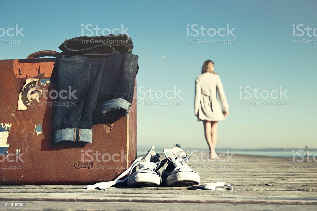 adventurous woman is walking toward its destination stock photo
