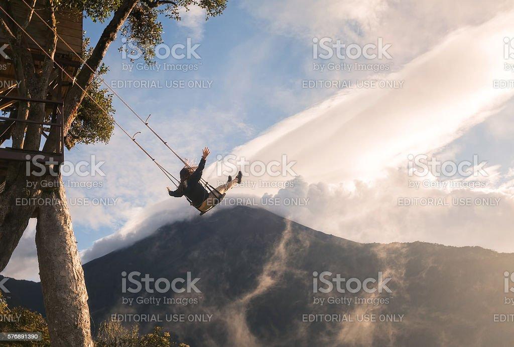 Adventurous Woman On The Swinging Seat At Casa Del Arbol stock photo