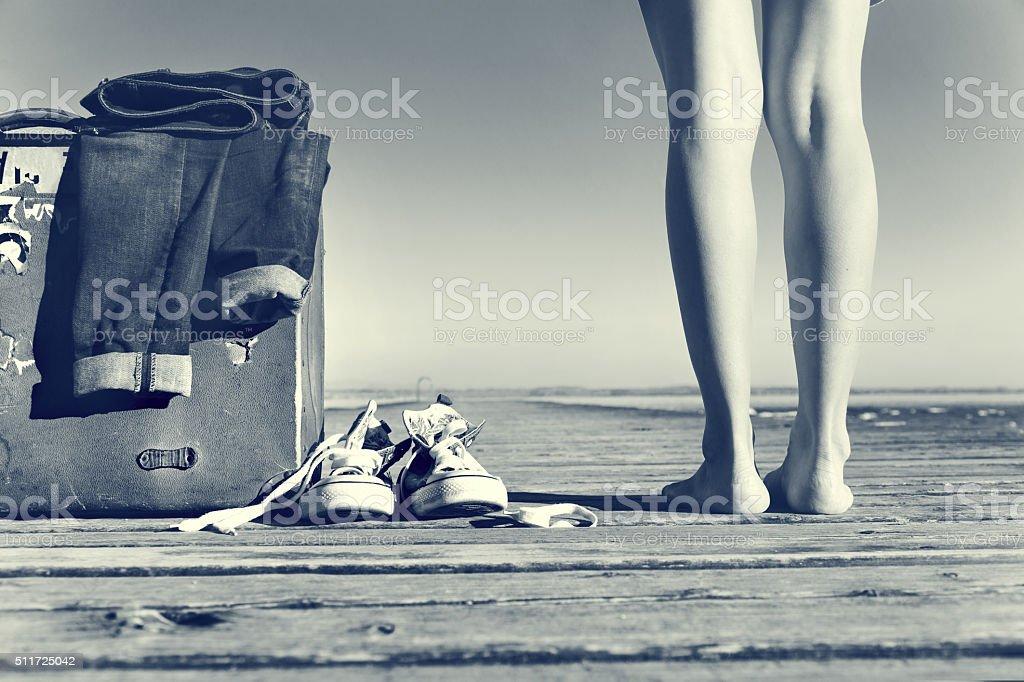 adventurous woman reaches her destination to the sea stock photo