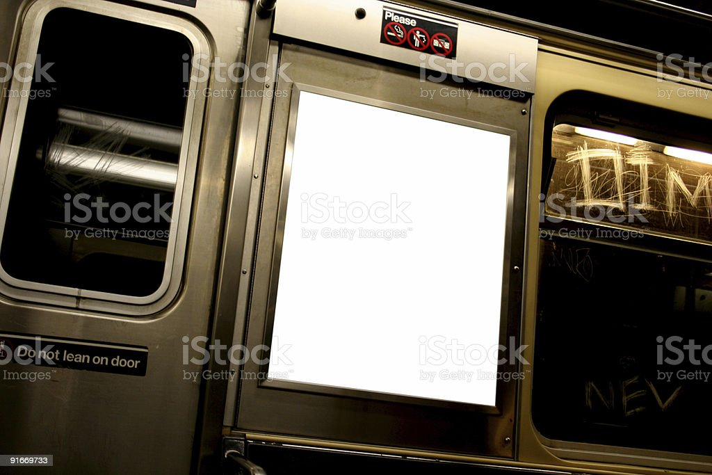 Advertise here billboard in white on subway stock photo
