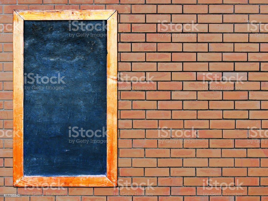 Advertisement chalkboard on the brick wall background stock photo