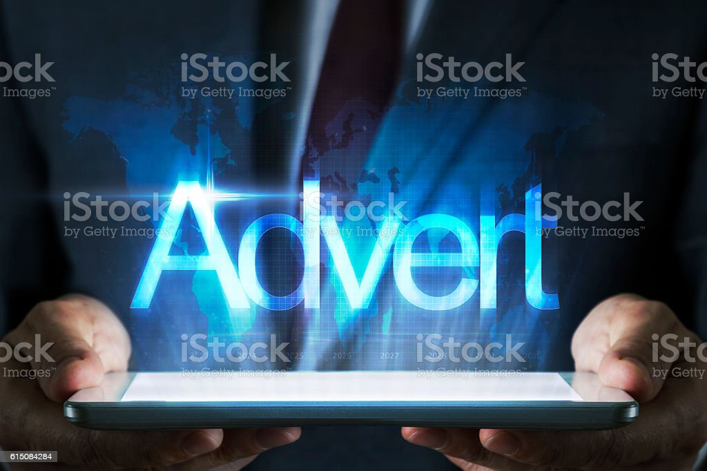 Advertisement concept on tablet with hologram stock photo