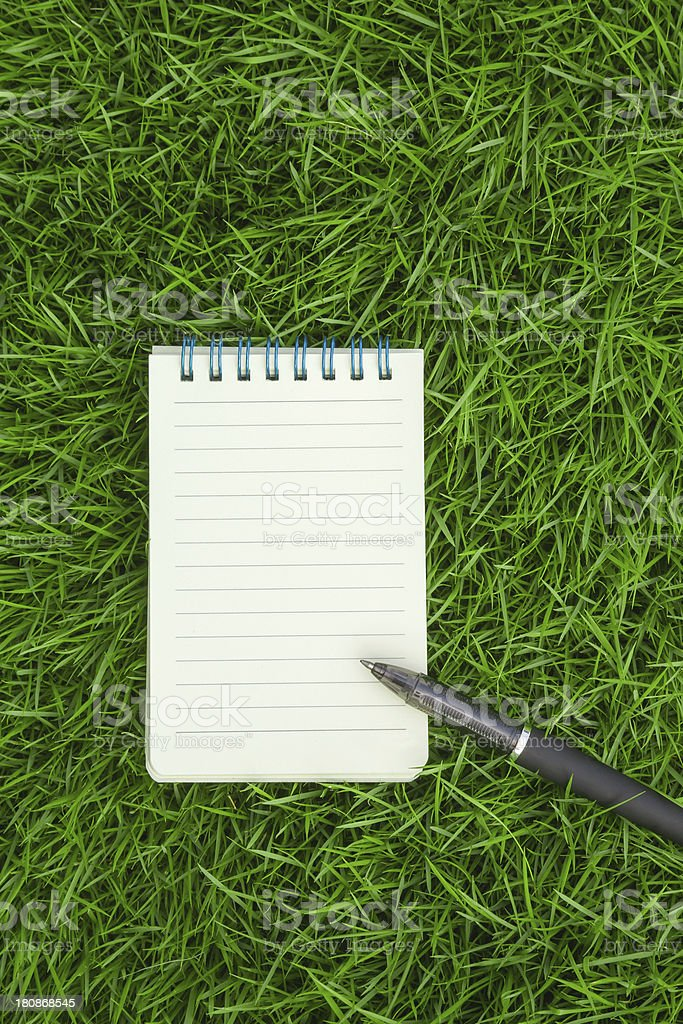 Advertisement:notebook on grass royalty-free stock photo