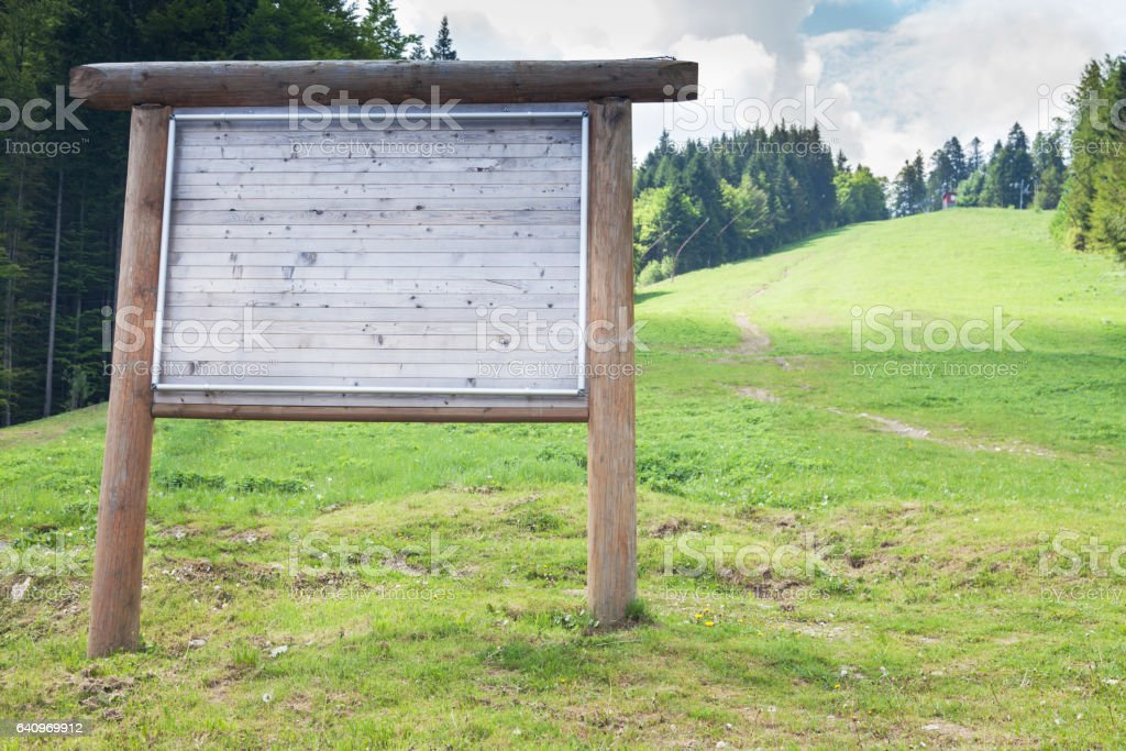 Advertising billboard outside the mountain in the summertime stock photo