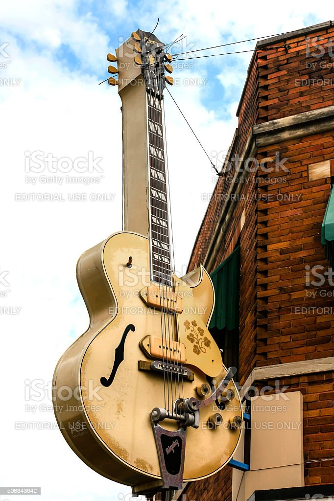 Advertising guitar hang from Sun Studio building in Memphis TN stock photo