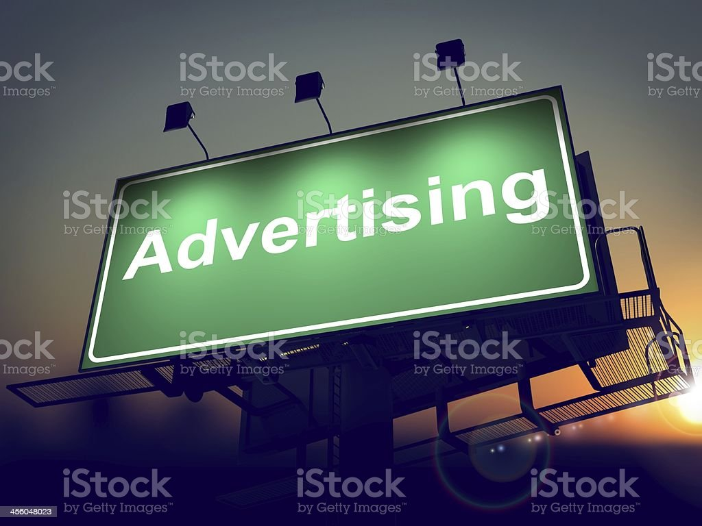 Advertising on Green Billboard at Sunrise. stock photo