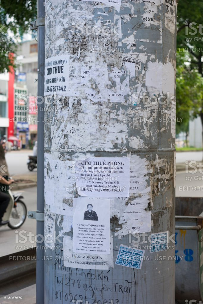 Hanoi, Vietnam - Sept 21, 2014: Advertising papers on electricity pole on Thanh Xuan st, Hanoi, Vietnam stock photo