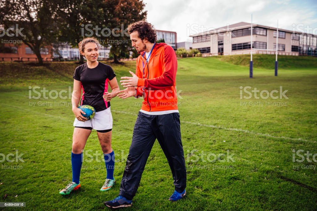 Advice from her Rugby Coach stock photo