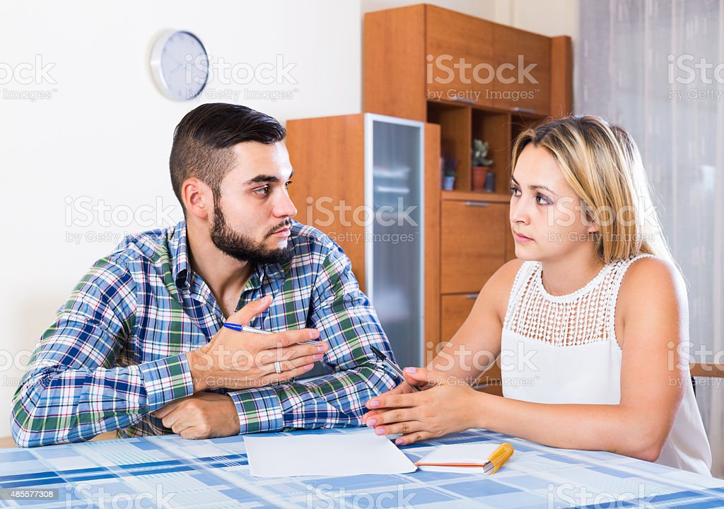 Advisor consulting struggling young woman stock photo