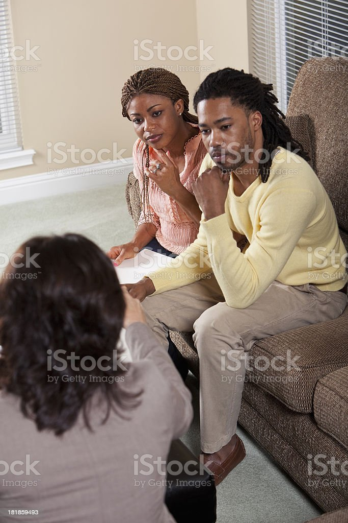 Advisor with African American couple stock photo