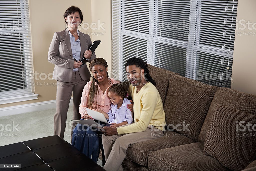 Advisor with African American family stock photo