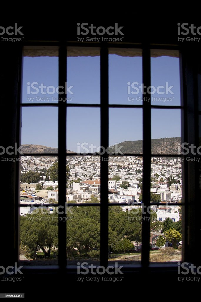 Aegean town behind the bars stock photo