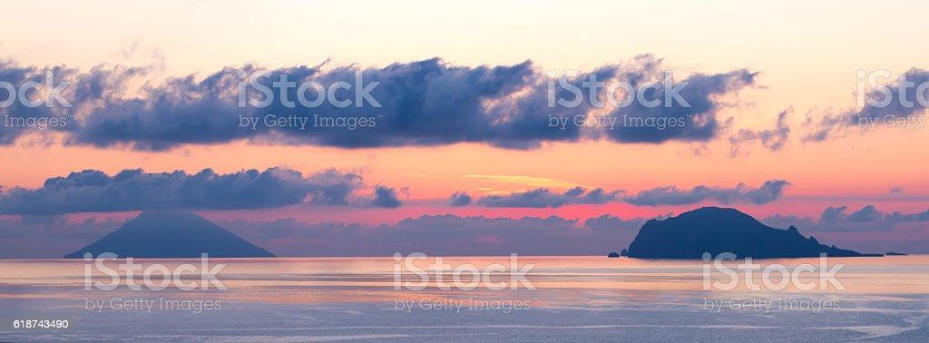 Aeolian Seascape/Panorama: Stromboli and Panarea at Dawn stock photo