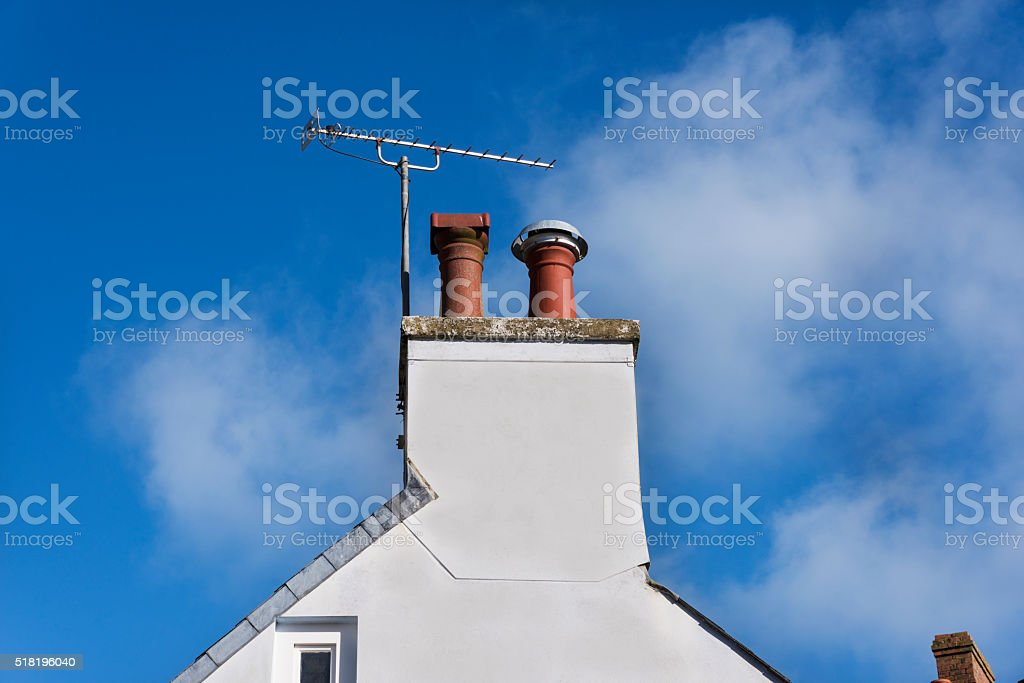 TV Aerial and Chimney stock photo