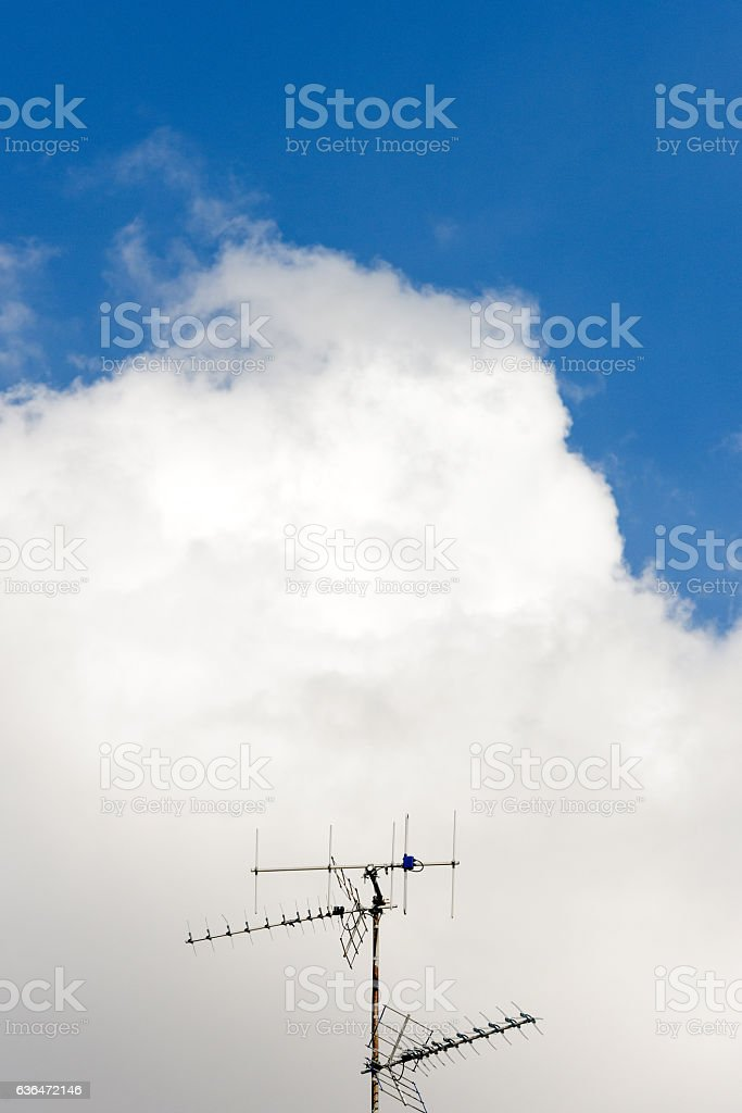 Aerial antenna against blue sky stock photo