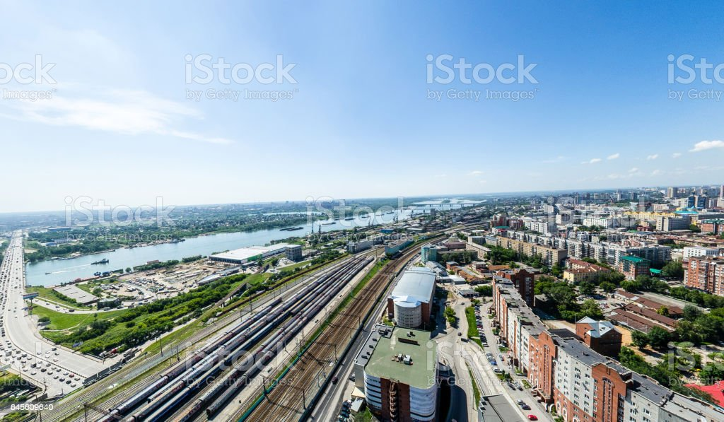 Aerial city view with roads, houses and buildings stock photo
