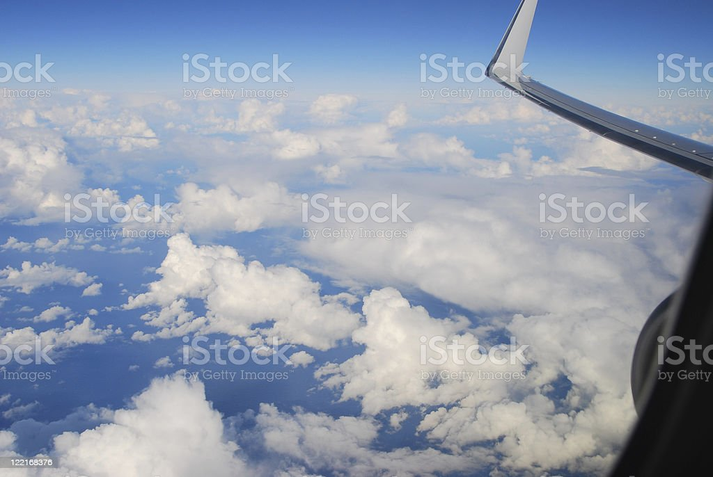 Aerial Cloudscape with clouds and aeroplane wing royalty-free stock photo