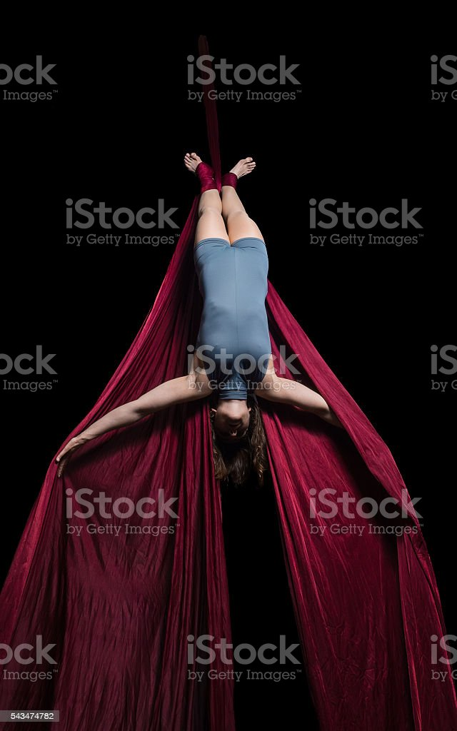 Aerial dancer woman isolated on black stock photo