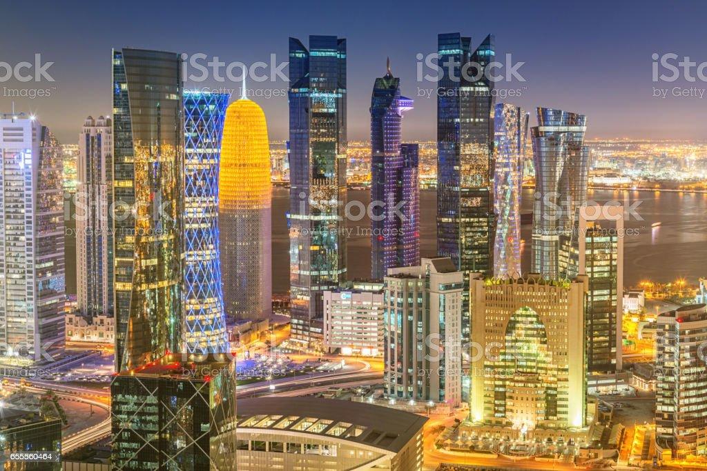 Aerial Doha Qatar Modern Skyscrapers at Night stock photo