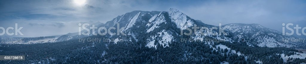 Aerial drone panorama.  Flatiron mountains of Boulder, Colorado after blizzard stock photo
