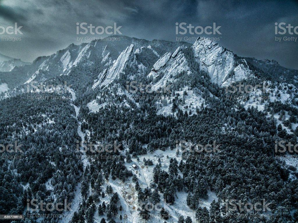 Aerial drone photo.  Flatiron mountains of Boulder, Colorado after blizzard stock photo