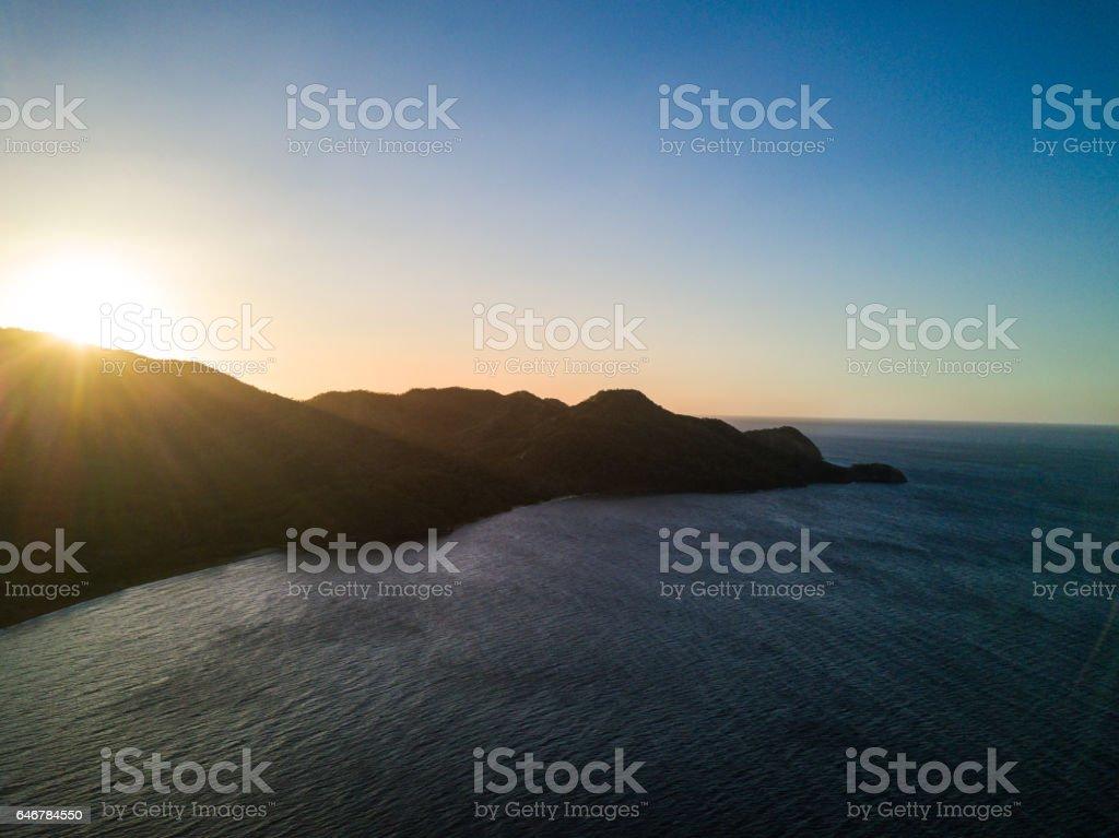 Aerial drone sunset photo, rugged coastline of Costa Rica stock photo